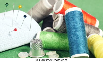 Tools for tailoring - Colorful thread bobbins, buttons,...