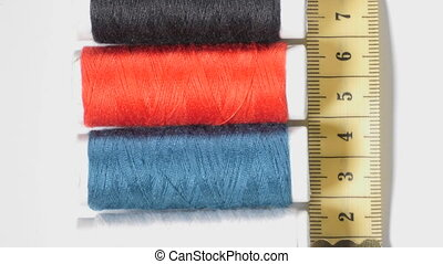 Bobbins with measuring tape - Set of multicolored spools...