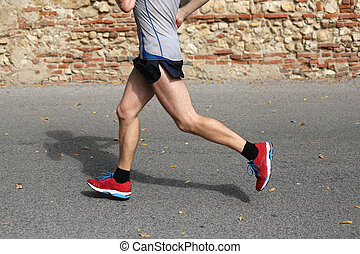 fast runner running fast with by red gym shoes on the...