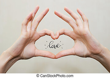 Fingers in heart shape. Love