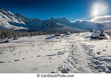 Mountain hut in winter at sunset in Poland