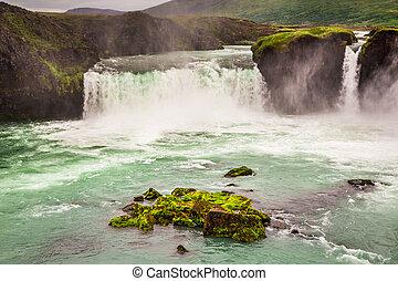 Beautiful Godafoss waterfall with blue water in summer