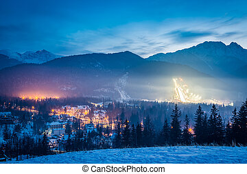 Skiing competitions in Zakopane in winter at dusk in Poland