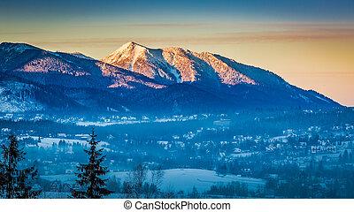 Sunrise in Zakopane with illuminated peak in winter, Tatra...