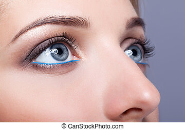 Closeup shot of female eyes with day makeup