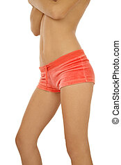 Woman torso - Torso of slim tanned woman in pink shorts over...