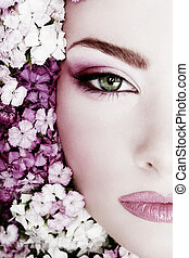 Girl in flowers - Black and white painted close-up portrait...