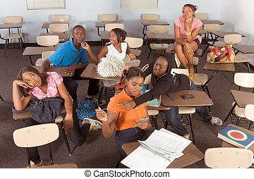 Highschool students messing in class during break - High...