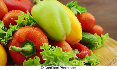 Fresh Vegetables Rotate on Wooden Board: Carrot, Cucumber,...