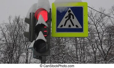 snowy stoplight at the intersection