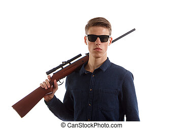 Young man with a rifle