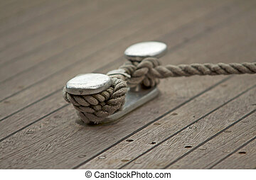 Ropes - Closeup of ropes fixed on a wooden boat