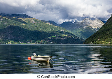 Boat on the Storfjord in Norway - A boat on the Storfjord in...