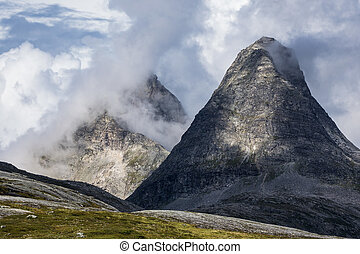 Landscape with mountains and clouds in Norway.