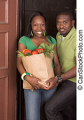 Black couple coming with groceries shopping - Young ethnic...
