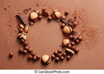 delicious chocolate candies - round frame of chocolates on a...
