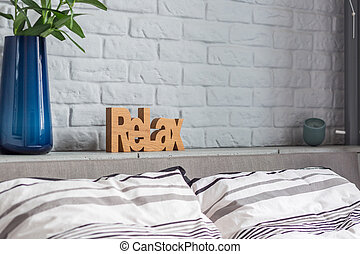 Stylish decorations in new bedroom with double bed and brick...