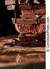 Heap of broken pieces chocolate - chocolate syrup being...