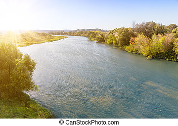 Riverbed on sunny day - Bend of the river on sunny day with...