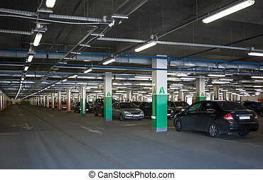 Subterranean parking lot - A subterranean car park in a...