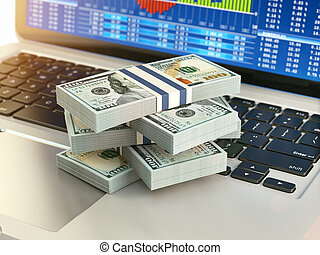 Stock market online business concept. Pack of dollar on laptop keyboard with stock market char on the screen.