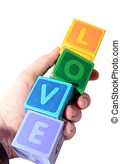 love in wooden play block letters held in hand