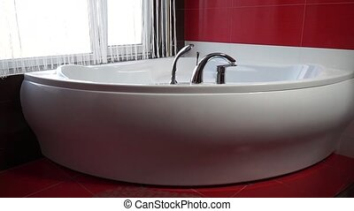 Zoom a white bath in red bathroom
