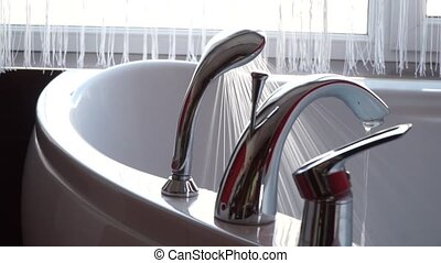 From the tap and shower water flowing in jacuzzi