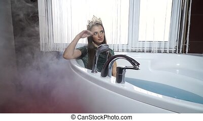 Fashion model in a jacuzzi in the bathroom to smoke -...