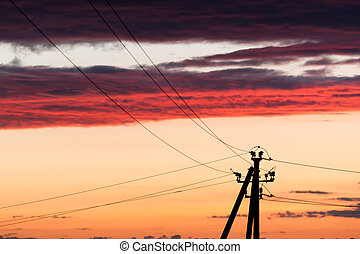 Electric line against colorful sky at sunset - Electric...