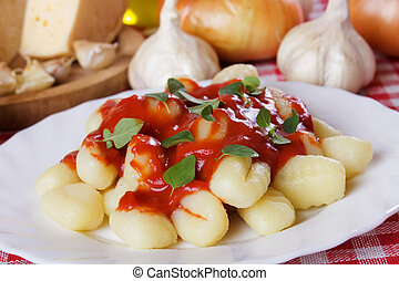 Gnocchi di patata, italian potato noodles with tomato paste...
