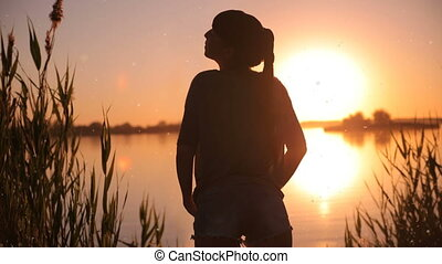 Girl on the lake at sunset. Live Picture Animation