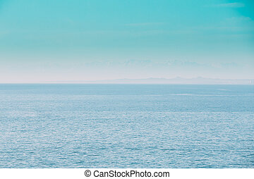 Calm Sea Ocean And Blue Clear Sky Background. Gently Blue Color