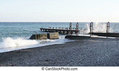 waves breaking on breakwater - Sea waves breaking on the old...
