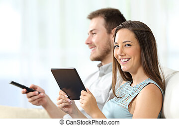 Couple enjoying tv and looking you - Couple watching tv...