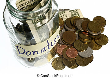 Donation concept glass jar full of coins and dollar