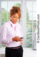 Text Messaging - Attractive Businesswoman Sending A Text...