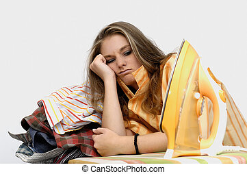 Frustrated woman at ironing board
