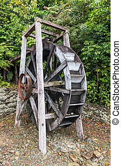 restored wooden watermill wheel - closeup of restored wooden...