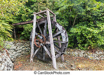 old wooden water mill wheel - closeup of old wooden water...