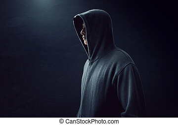 Man standing alone in dark room