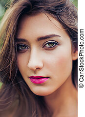 Closeup Portrait of a beautiful young woman with perfect skin