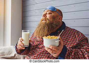 Happy thick guy eating cereals in morning - This is the best...