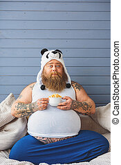 Fat man is ready for diet - Mature thick guy is sitting on...