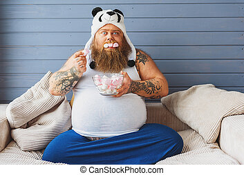 Greedy fat man eating sweet food - Hungry male gourmand is...