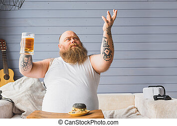 Happy thick guy is grateful for beer - This is beverage of...