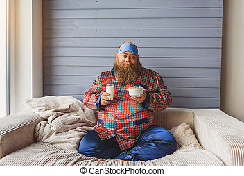 Sleepy thick guy eating cereals with milk - Good morning....