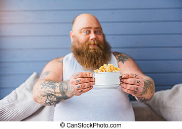 Cheerful male fatso dieting with cereals - I am ready for...