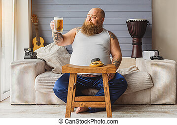 Happy fat man enjoying alcohol beverage - Beer is good....