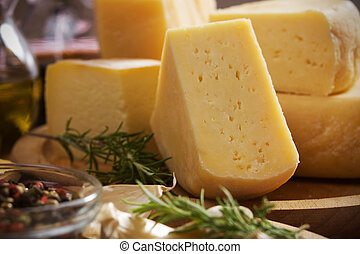 Hard cheese - Slices of hard italian cows cheese, selective...